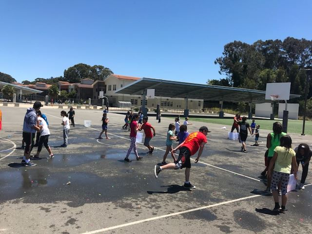 Teen participants playing with Water Balloons outside