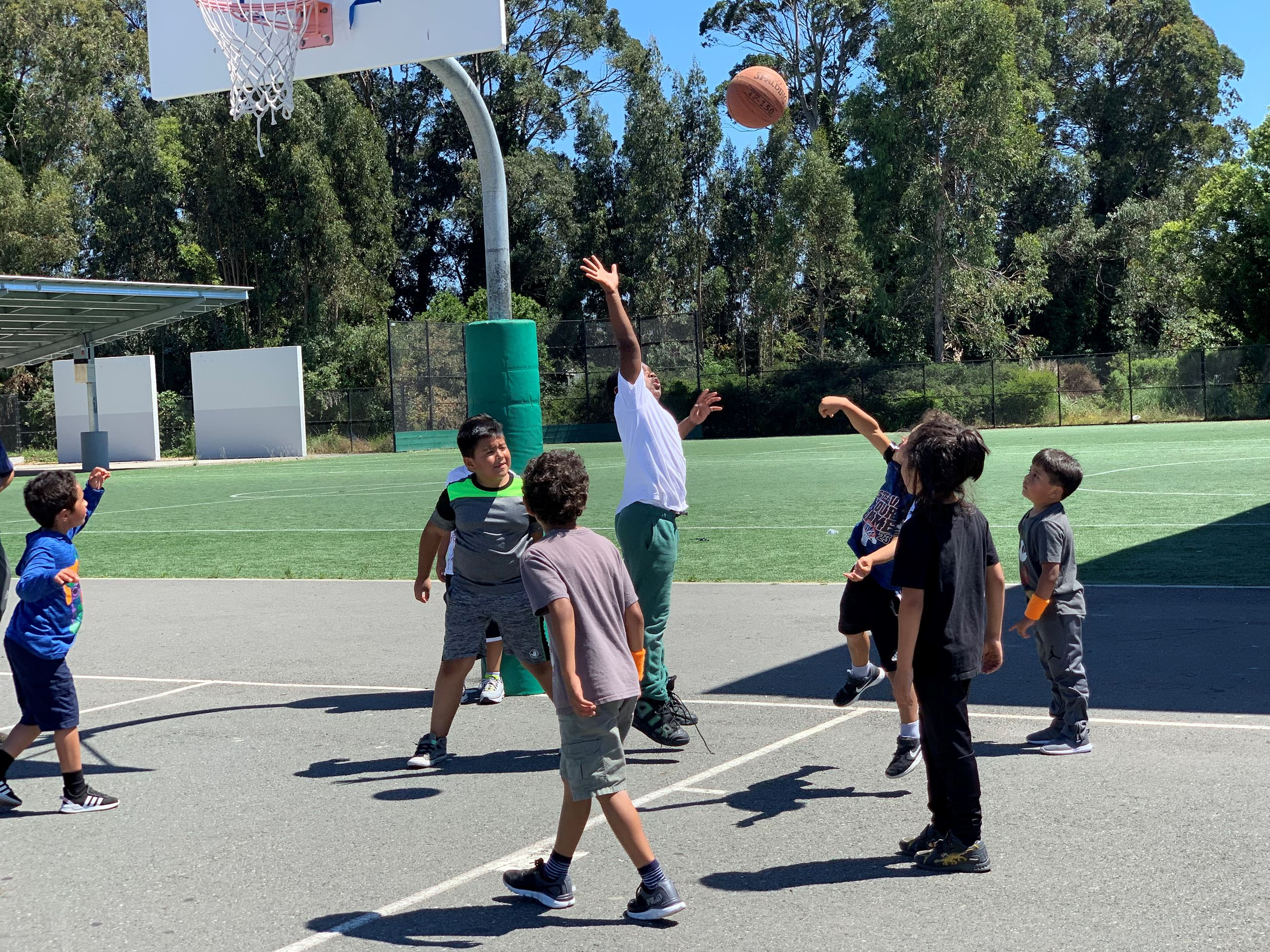 Basketball Camp Participants Blocking and Shooting the ball