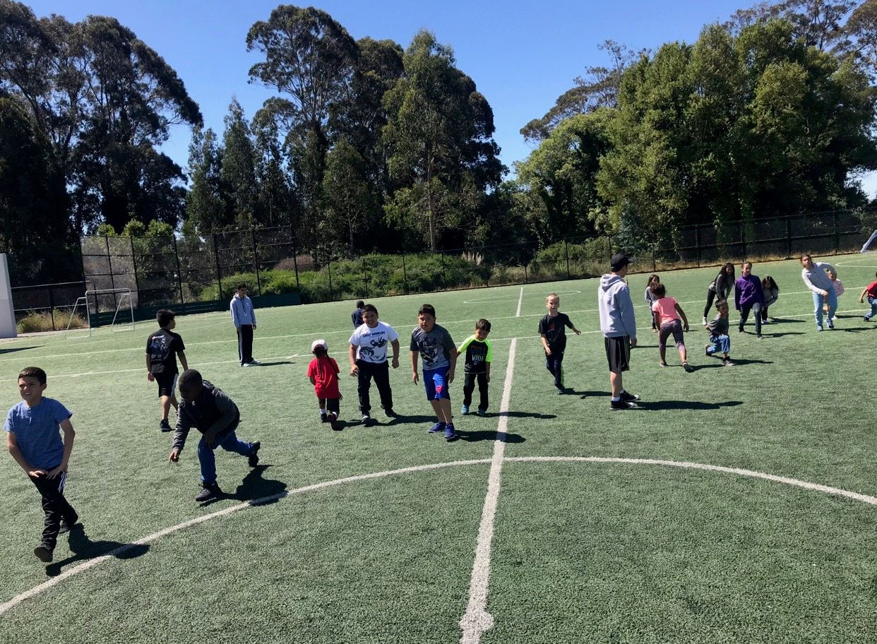 Camp participants playing on field
