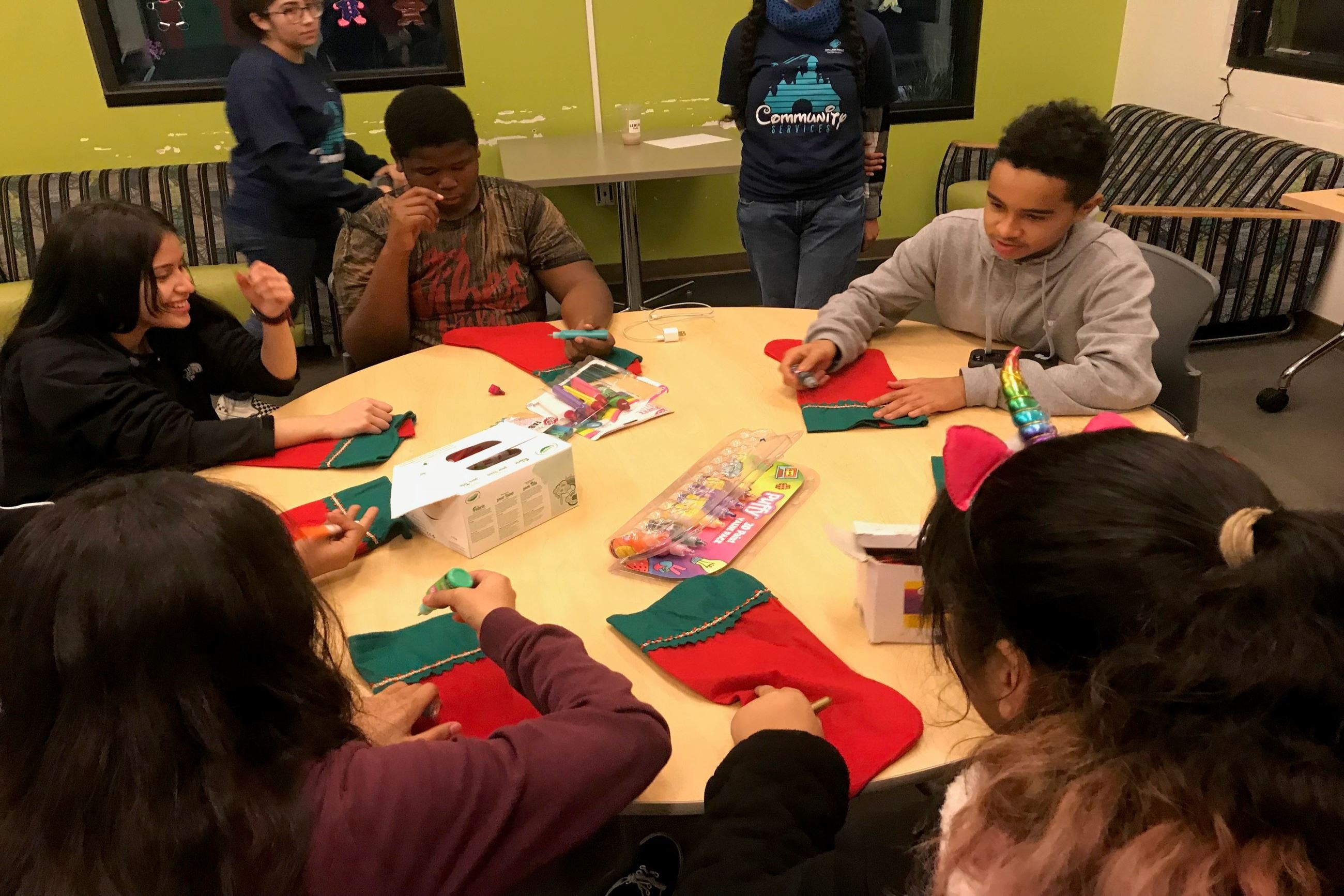 Teen Lounge Participants decorating Stockings