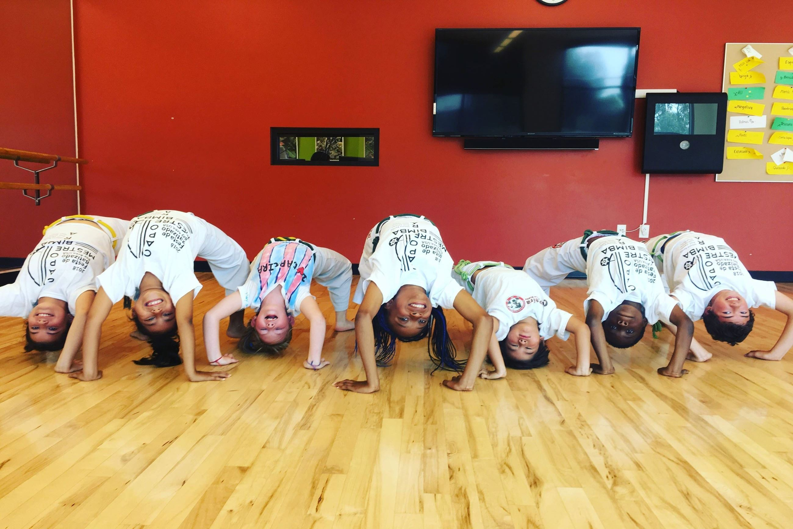 Capoeira Participants doing a Back Hand Stand