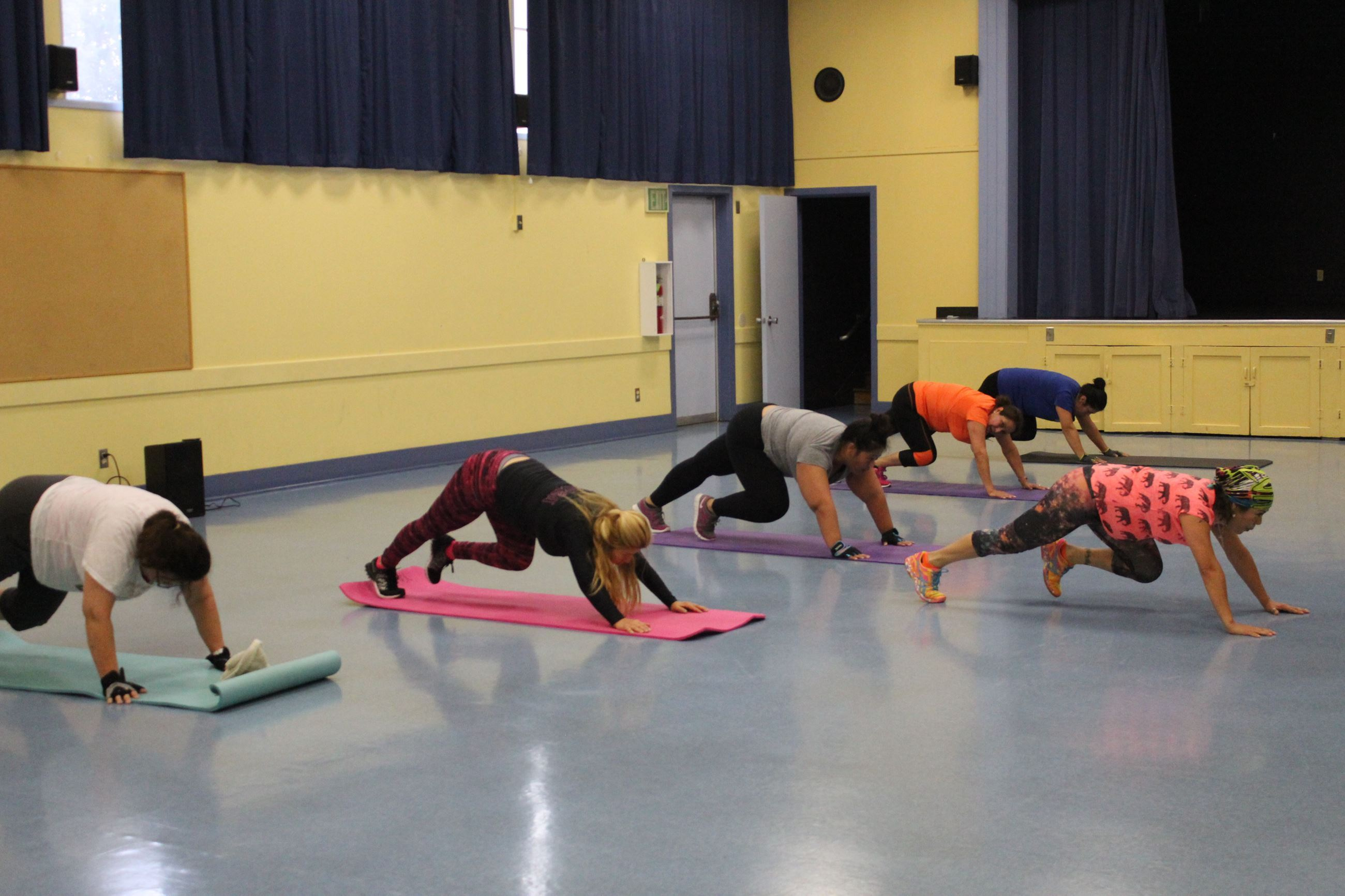Fitness Class Participants Stretching