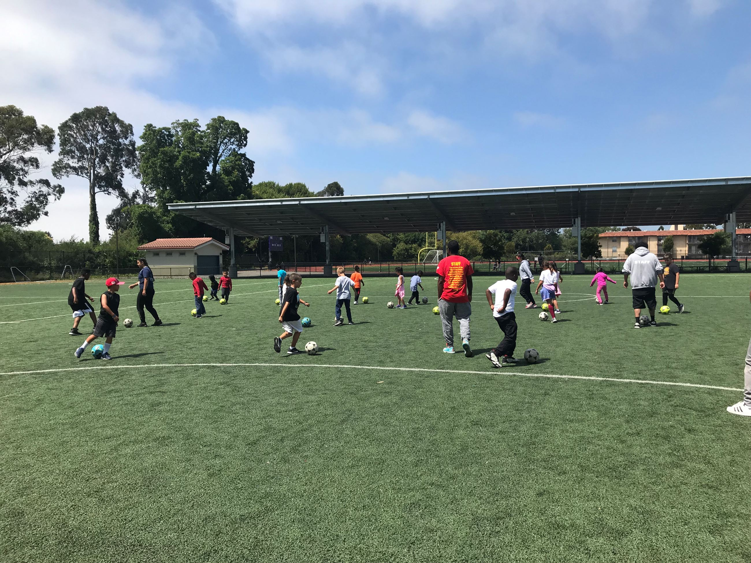 Soccer Camp participants playing soccer