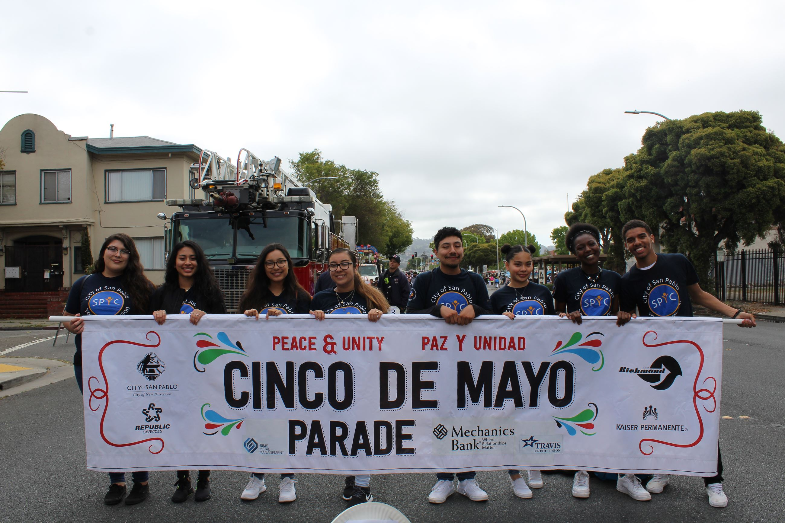 San Pablo Youth Commissioners Holding Peace and Unity Parade Banner During Parade