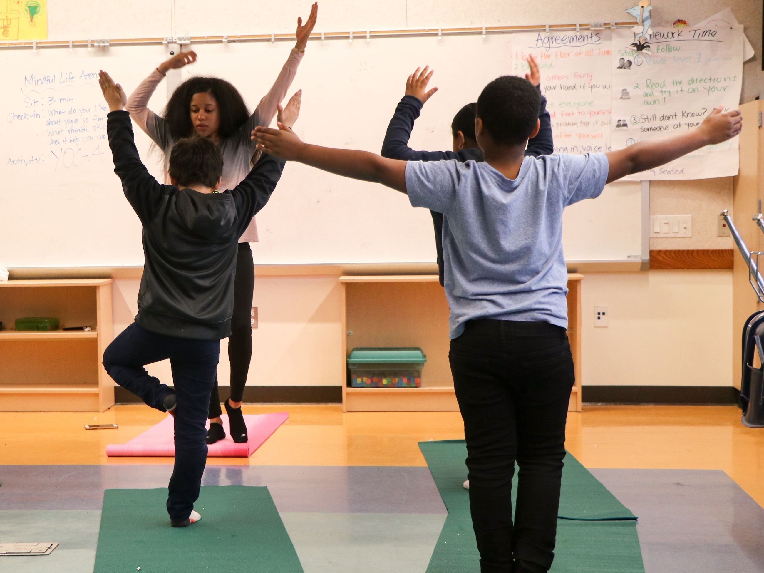 Students Practicing Yoga Poses in Mindful Life Group